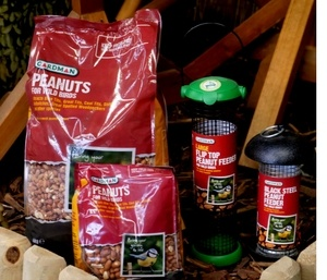Two Bags of Peanust for birds and two varieties of peanut feeder